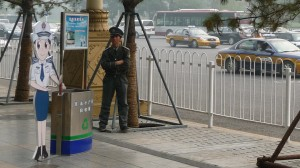 Policeman and advertisement, Beijing