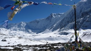 Mountains and prayer flags in Tilicho Lake, Annapurna, Nepal