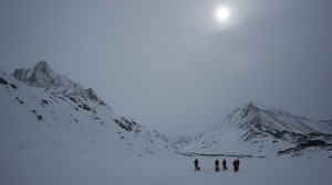 Skiing with a pulk, cloudy day, Greenland